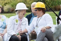 Two women in hard hats at a Blue Heron Foundation event