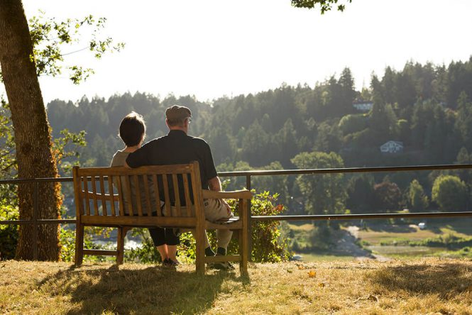 A couple on a bench enjoying nature at Willamette View