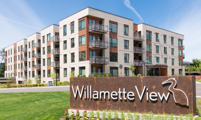 exterior shot of north point homes with Willamette View sign in the foreground